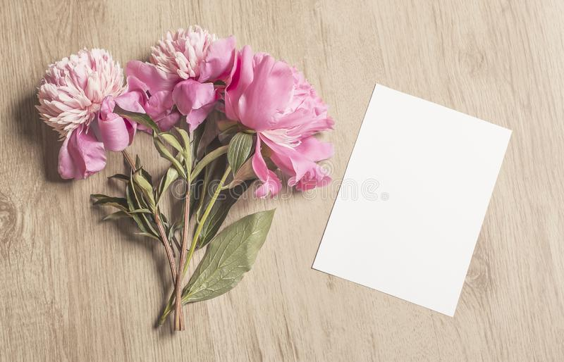 Lovely Feminine Mockup With A Vertical Blank Invitation And Peony Flowers royalty free stock photos