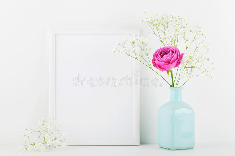 Mockup of picture frame decorated rose flower in vase on white background with clean space for text and design your blogging. stock photos