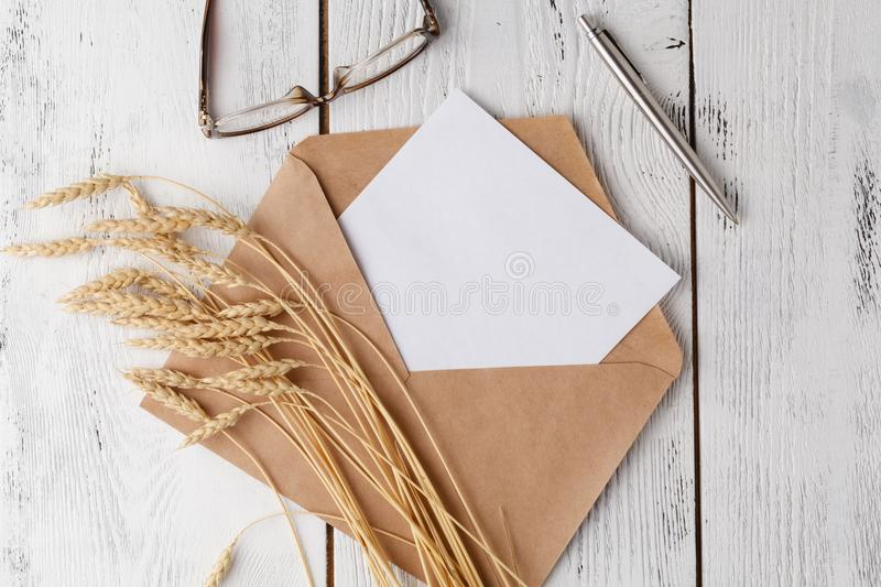 Mockup with postcard and golden rings on white background. stock photos