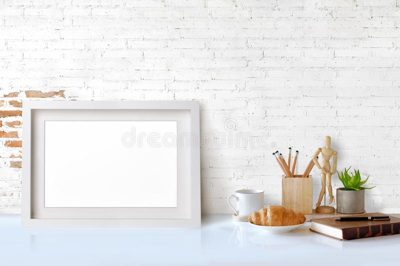 Mockup poster in hipster style workspace royalty free stock photography