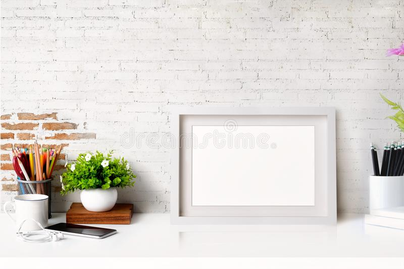 Mockup poster in hipster style workspace stock photo