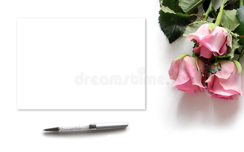 Mockup for presentations with roses. Desktop top view. Modern trend template for advertising royalty free stock image