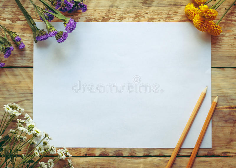 Mockup with spring flowers and blank paper. Vintage style stock images