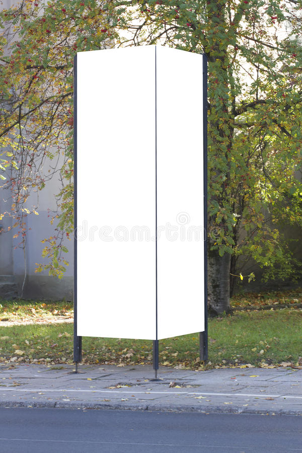 Mockup street advertising or information column stand on sidewalk. Street advertising or information column stand on sidewalk. Mockup stock images