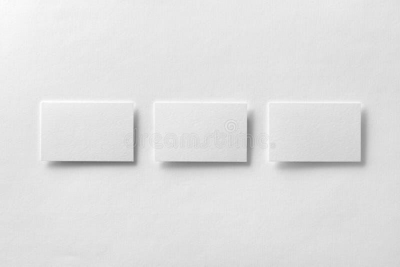Mockup of three business cards row at white textured paper backg download mockup of three business cards row at white textured paper backg stock photo image colourmoves