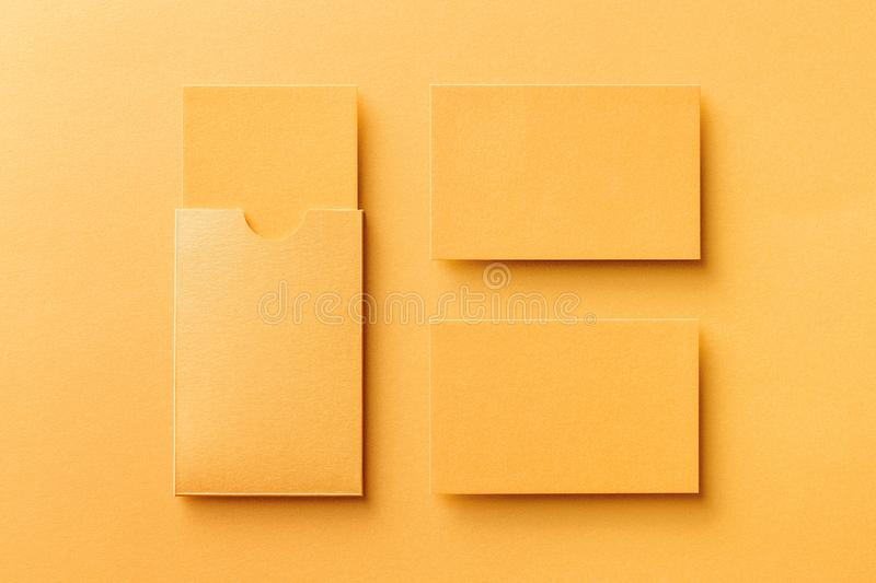 Mockup of two blank business cards and a cardholder at golden paper royalty free stock photo