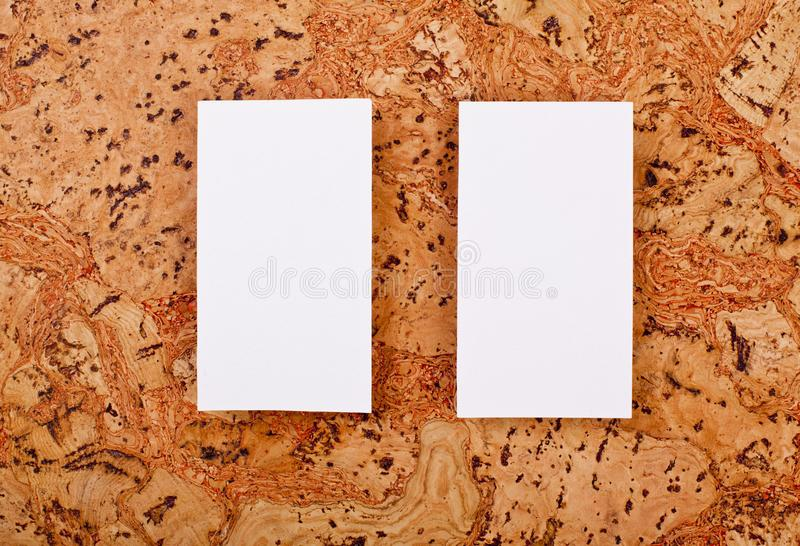 Mockup of white business cards at a cork background stock photo download mockup of white business cards at a cork background stock photo image of communication colourmoves