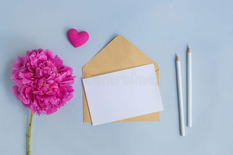 Mockup white greeting card and envelope with pink peony royalty free stock photo