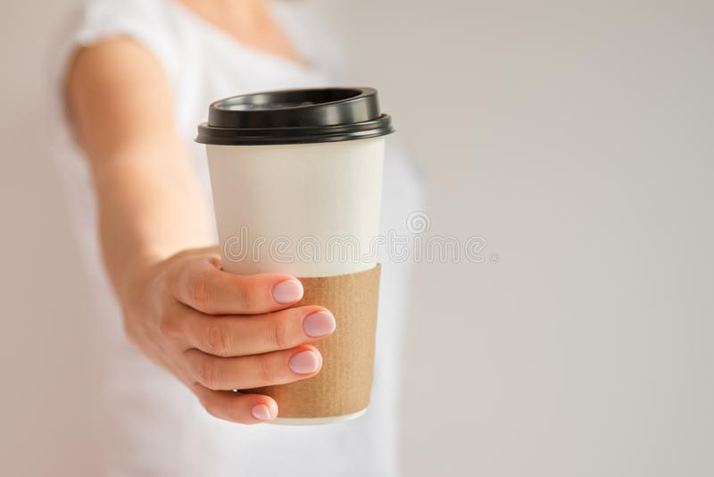 Mockup of woman hand holding a Coffee paper cup royalty free stock photos