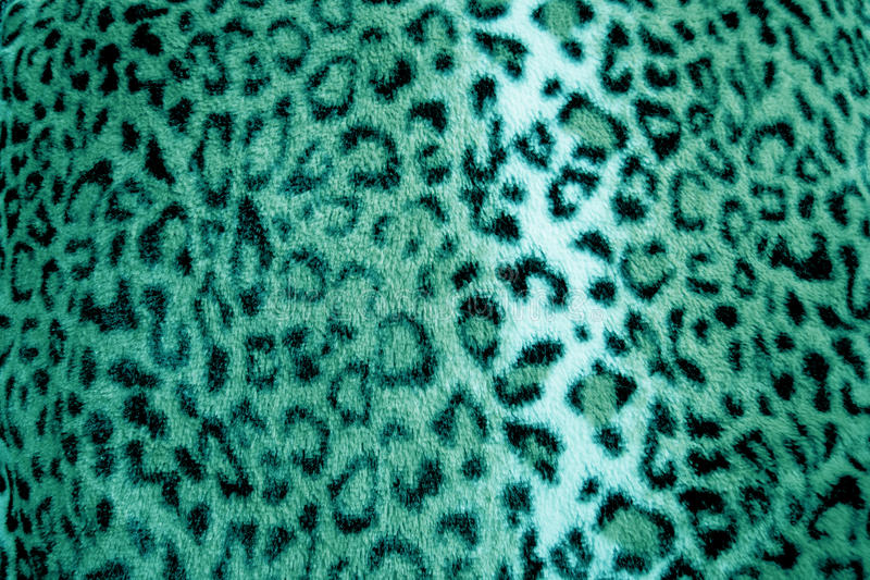Modèle animal de fourrure d'impression de léopard vert - tissu images stock
