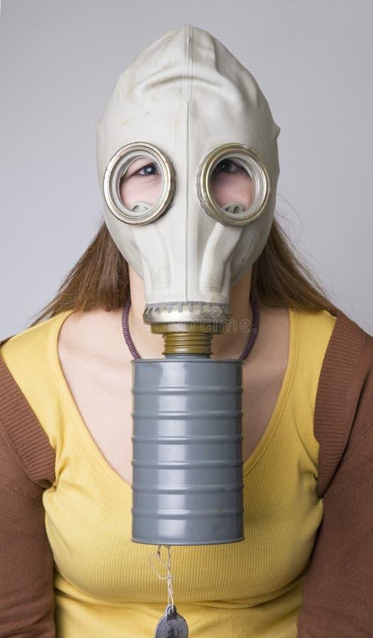 Modèle avec le masque de gaz photographie stock