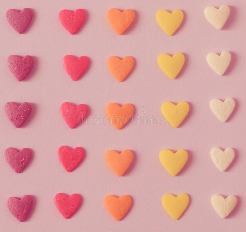 Modèle coloré de coeurs de sucrerie image stock