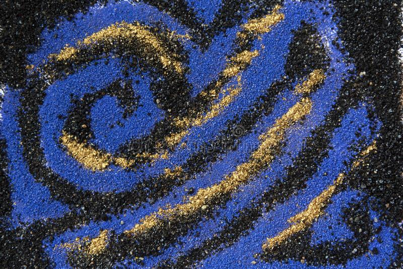 Modèle coloré posé de sable Fond de marbre de style Texture de poudre de bleu et d'or photographie stock