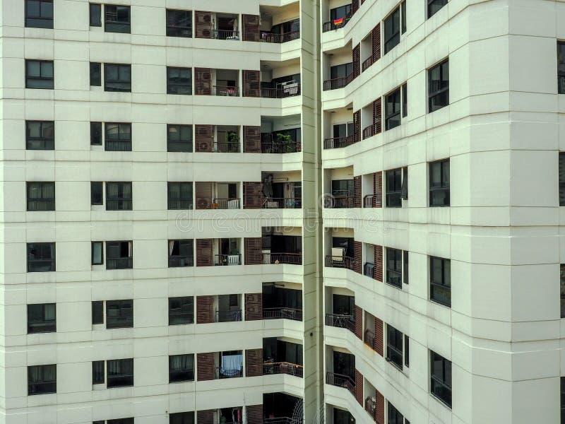 Modèle de bâtiment de façade dans le logement moderne d'appartement Abrégez le fond d'architecture photos libres de droits