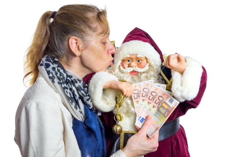 Modèle de baiser de femme de Santa Claus photo stock