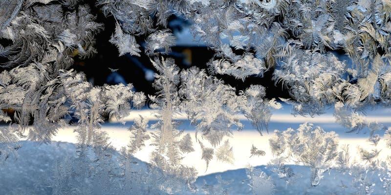 Modèle de gel d'hiver sur le verre photographie stock