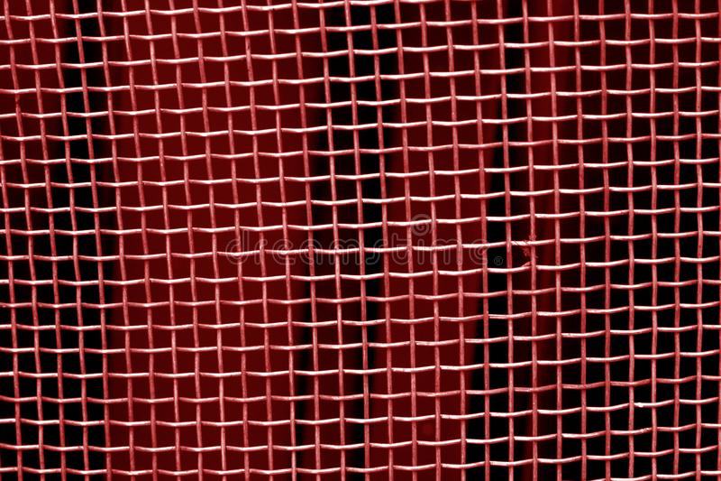 Modèle de grille de maille en métal dans le ton rouge photo libre de droits