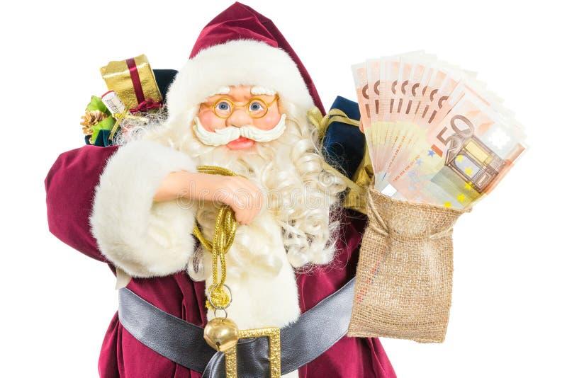 Modèle de Santa Claus avec les cadeaux et l'argent de sonnerie de cloche photographie stock libre de droits
