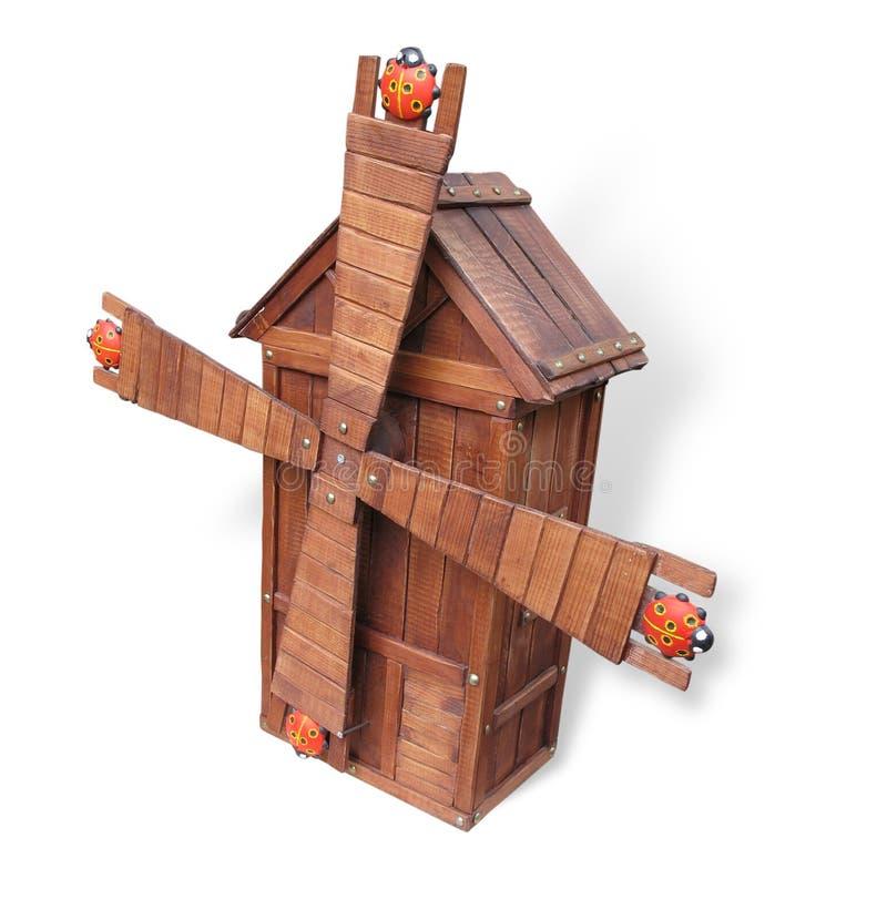 Modèle en bois de concept de moulin à vent d'isolement au-dessus du blanc photo stock