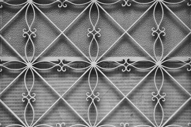 Modèle floral de cadre de porte en métal images stock