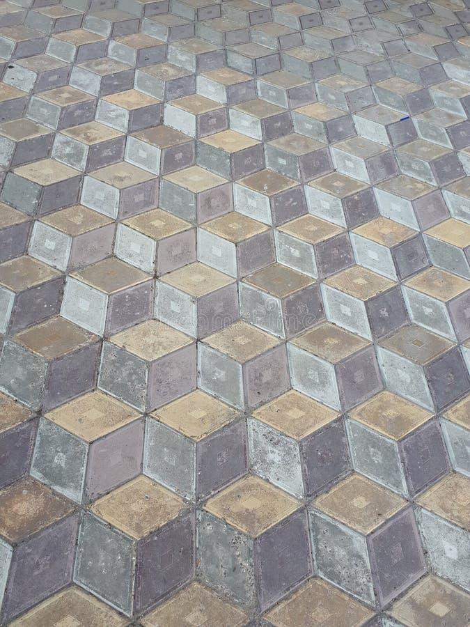 Modèle géométrique de nids d'abeilles d'illusion de tuile photos stock