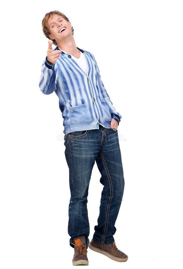 Modèle mâle beau dirigeant son doigt à vous photo stock