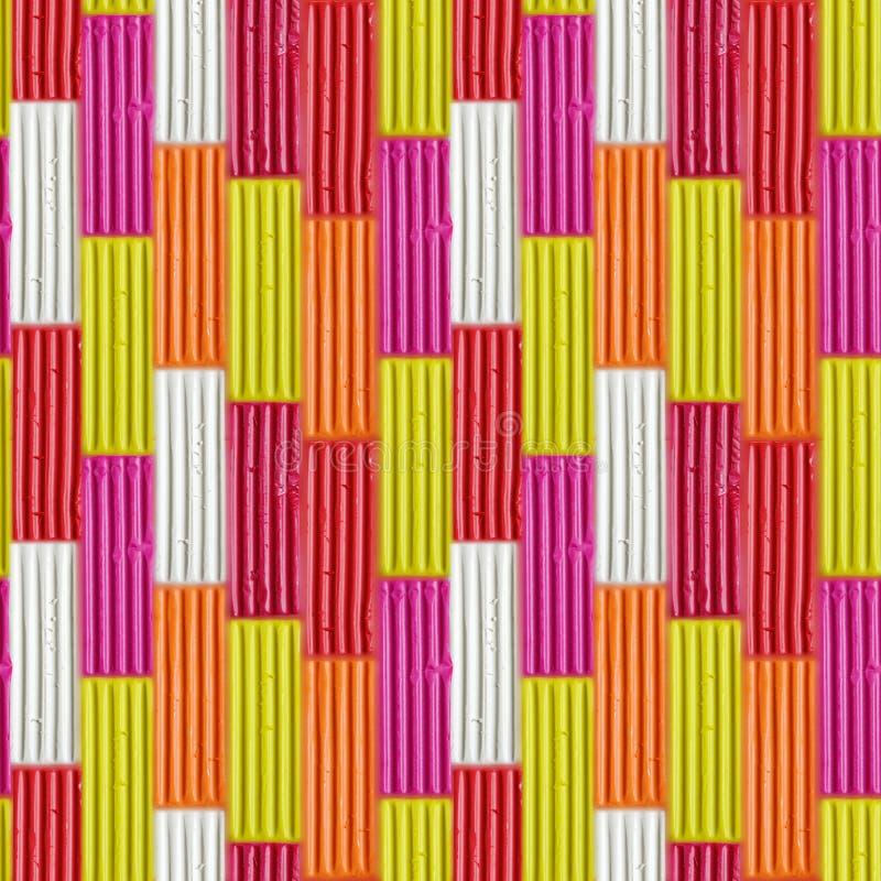 Modèle sans couture des bâtons colorés de pâte à modeler Morceau d'argile d'arc-en-ciel pour le jeu d'enfants et la créativité photographie stock libre de droits