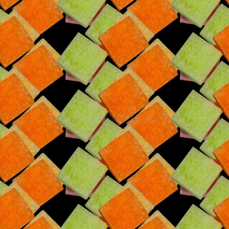 Modèle sans couture des morceaux colorés de sucre images stock