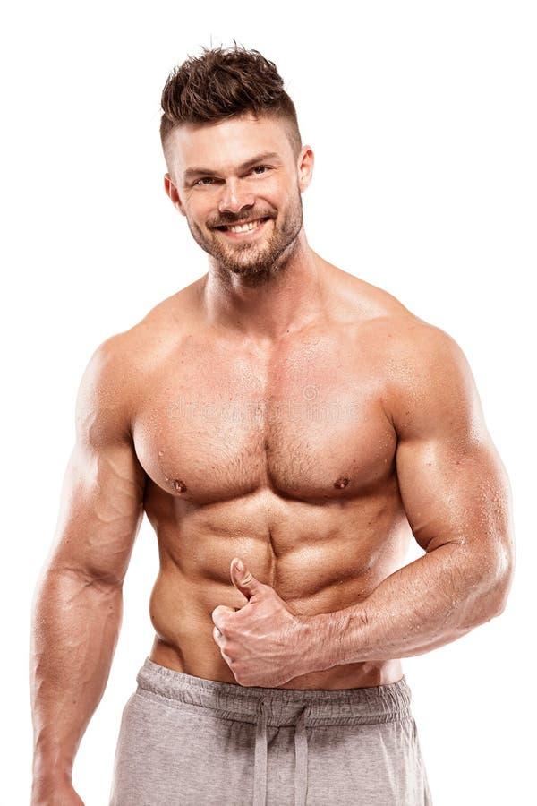 Modèle sportif fort Torso de forme physique d'homme montrant de grands muscles photos libres de droits