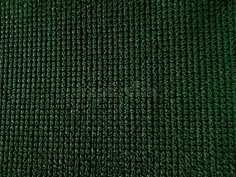 Modèle synthétique d'herbe de gazon vert pour le fond image stock