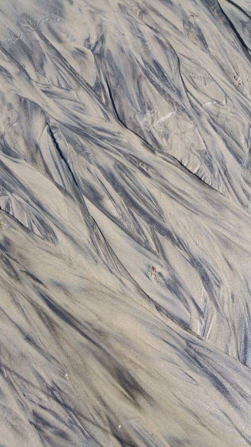 Modèles abstraits dans le sable sur la plage au vignoble le Massachusetts Etats-Unis du ` s de Martha images stock
