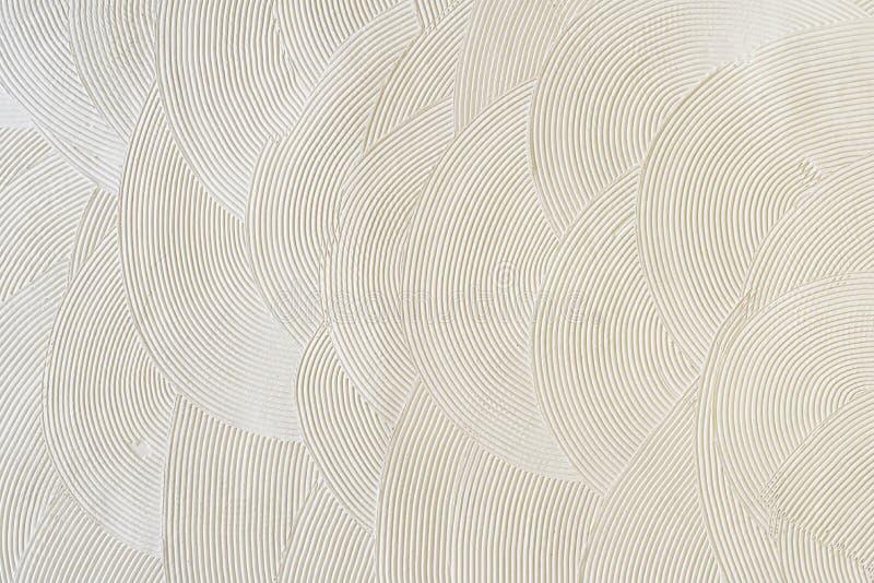 Modèles circulaires sur le plâtre blanc Texture abstraite photo libre de droits
