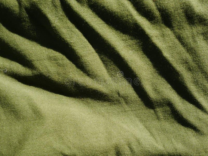 Mod?le de fond de texture Kaki en soie de tissu, vert, gris de champ Drapez, draperie photographie stock libre de droits