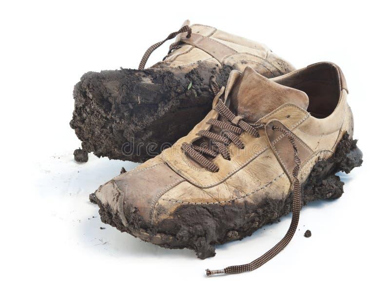 Modderig schoeisel stock foto