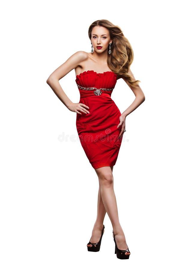Mode-Modell Red Dress, Frauen-Ganzaufnahme, Mädchen-Stand auf Weiß stockfotografie