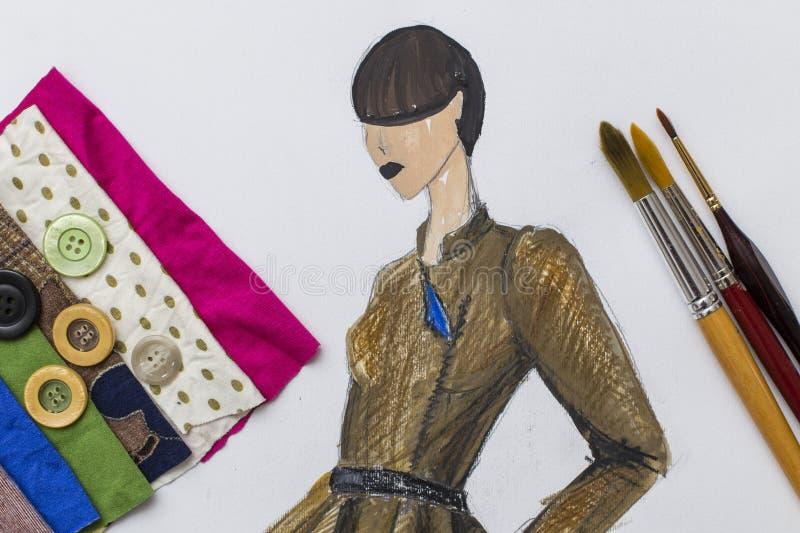 Modedesigne skissar royaltyfria bilder