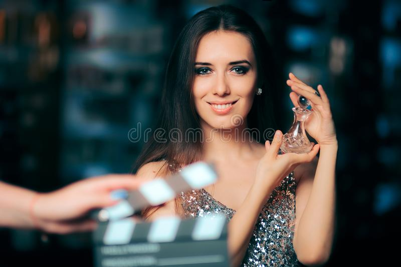 Model Acting in Perfume Commercial Ready to Film New Scene. Brand ambassador diva endorsing a product in cosmetics advertising campaigns stock images