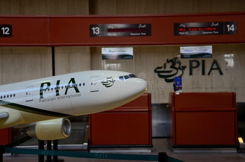 Model airplane in Pakistan International Airline PIA livery at Karachi Jinnah airport. Karachi, Pakistan - March 1, 2015: A model of a PIA airplane located in stock images