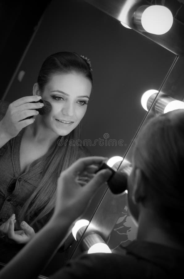 Model applying makeup stock photography