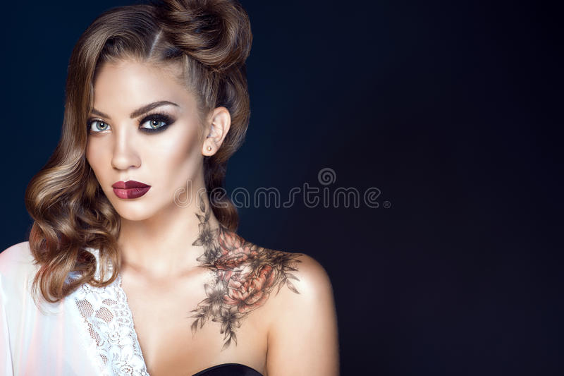 Model with artistic make up and hairstyle. Body art on her shoulder. Ideal woman concept. Close up portrait of glam model with artistic make up and hairstyle stock photography