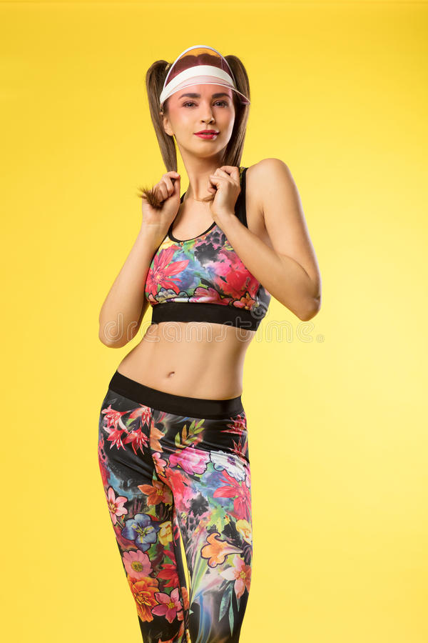 Model with athletic and slim body wearing leggins. stock photo