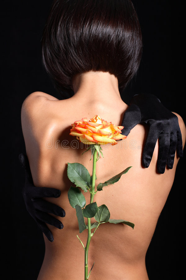 Free Model Back With Orange Rose Royalty Free Stock Photography - 8913907