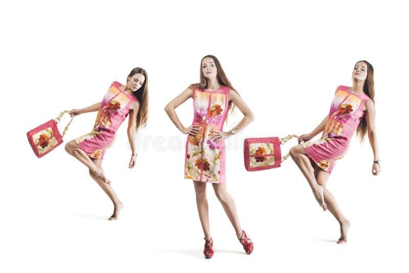 Model beautiful women in bright dresses in full length on white stock images