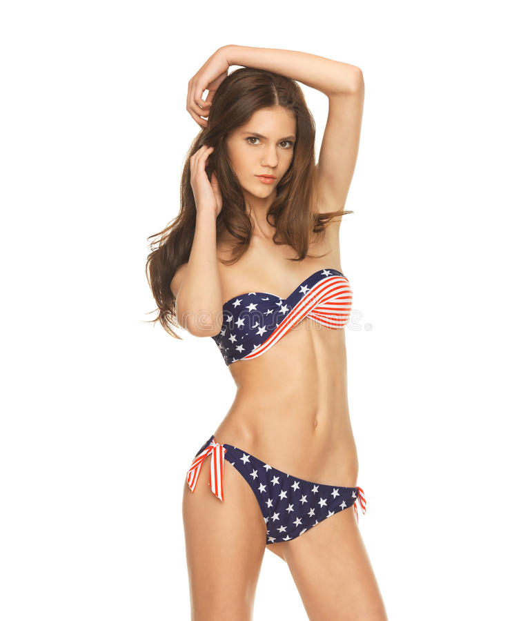 Model in bikini with american flag. Picture of model in bikini with american flag royalty free stock image