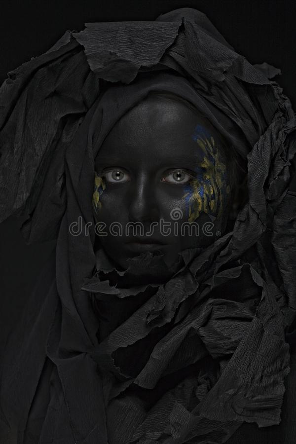 Model with black face. Art photo of a beautiful woman with black face stock photos