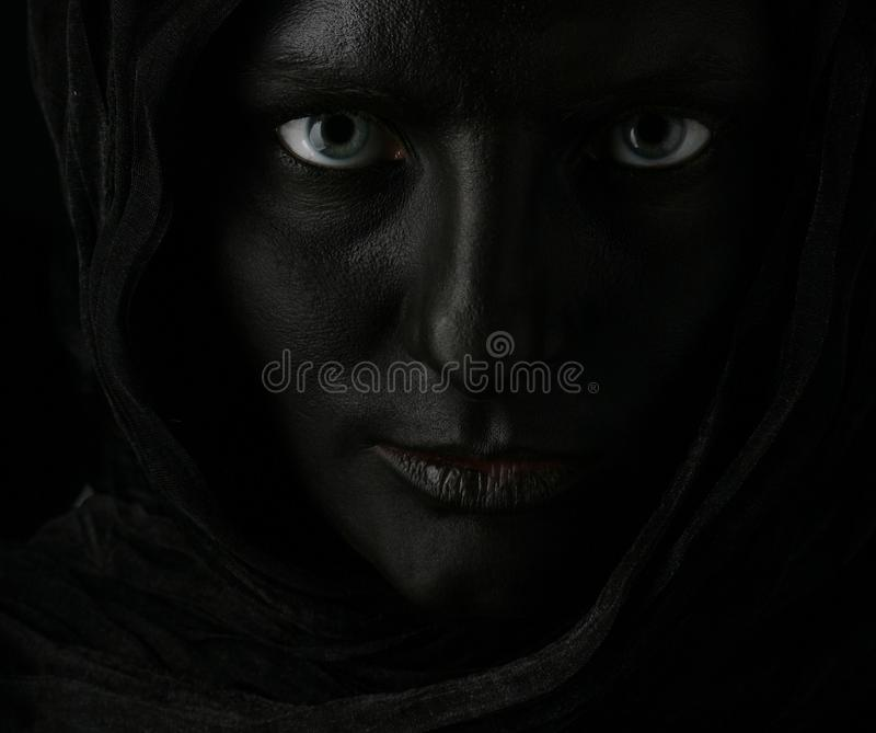 Model with black face. Art photo of a beautiful woman with black face royalty free stock photo