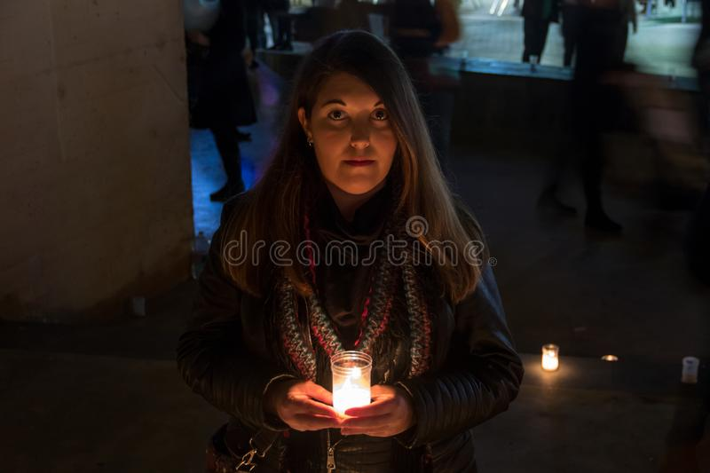 Model with black jacket in night photo with candles royalty free stock photography