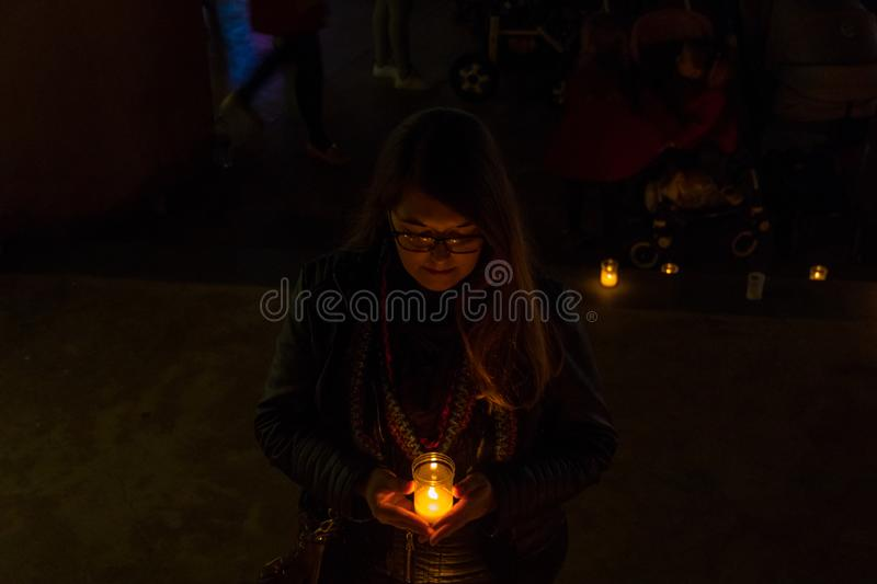 Model with black jacket in night photo with candles stock images