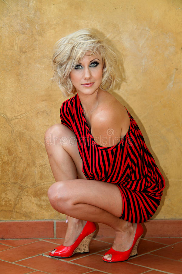 Model with black and red striped Bat wing sweater dress stock photos