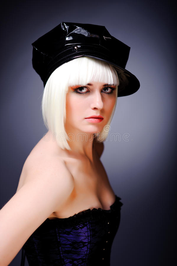 Model With Blonde Hair And Black Peaked Cap Stock Images